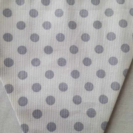 Tissu blanc à gros points gris