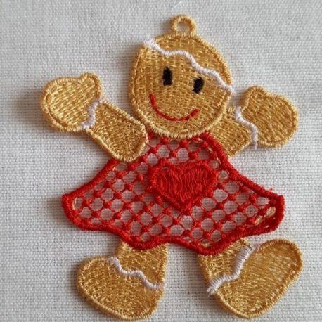 Broderie dentelle FSL, petit bonhomme pain d'épice en robe rouge