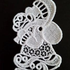 FSL, Broderie machine en dentelle couleur blanche représentant le Père Noël
