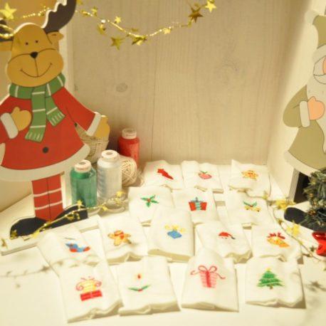 Broderie sur rond de serviette en tissu. Création artisanale Bébé Boutchou