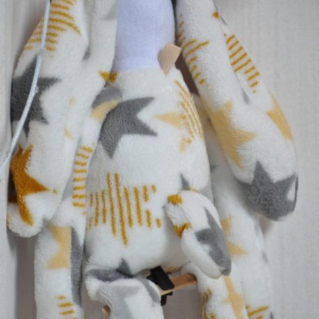 Lapin doudou polaire baby étoiles attache lange. Ouate 100% française